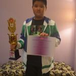 Fabian murid kelas 5 SD Tarakanita mendapatkan piala dan sertifikat. Selamat yaaa